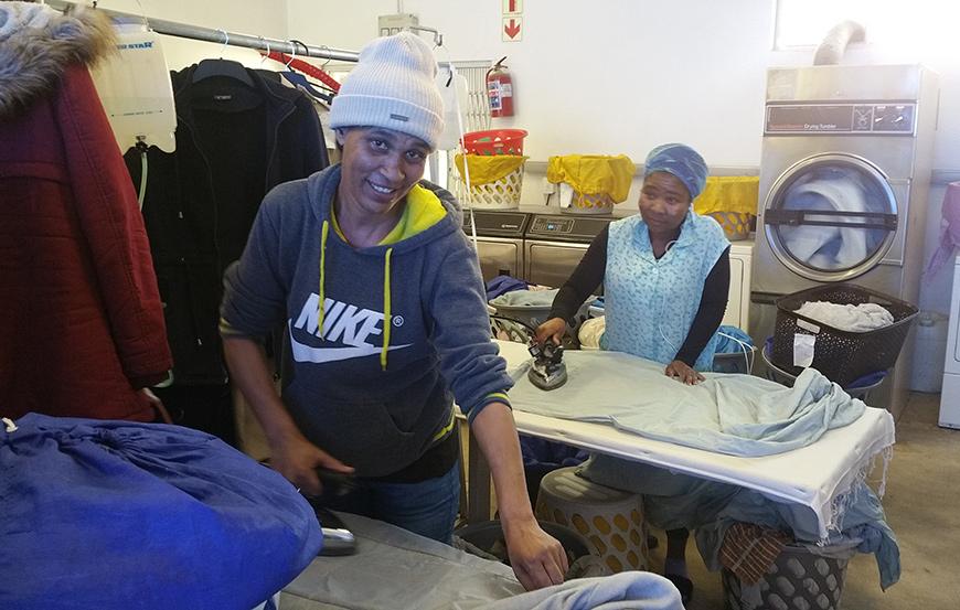 Diana & Unathi at ironing stations